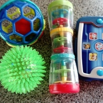Sensory toys. Both boys will knock something out of these and both love the pup pad!